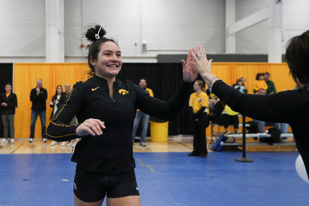Carina Tolan high fives assistant coach Jennifer Green before the Iowa women's gymnastics Black and Gold Intraquad Meet on Saturday, December 7, 2019 at the UI Field House. (Lily Smith/hawkeyesports.com)