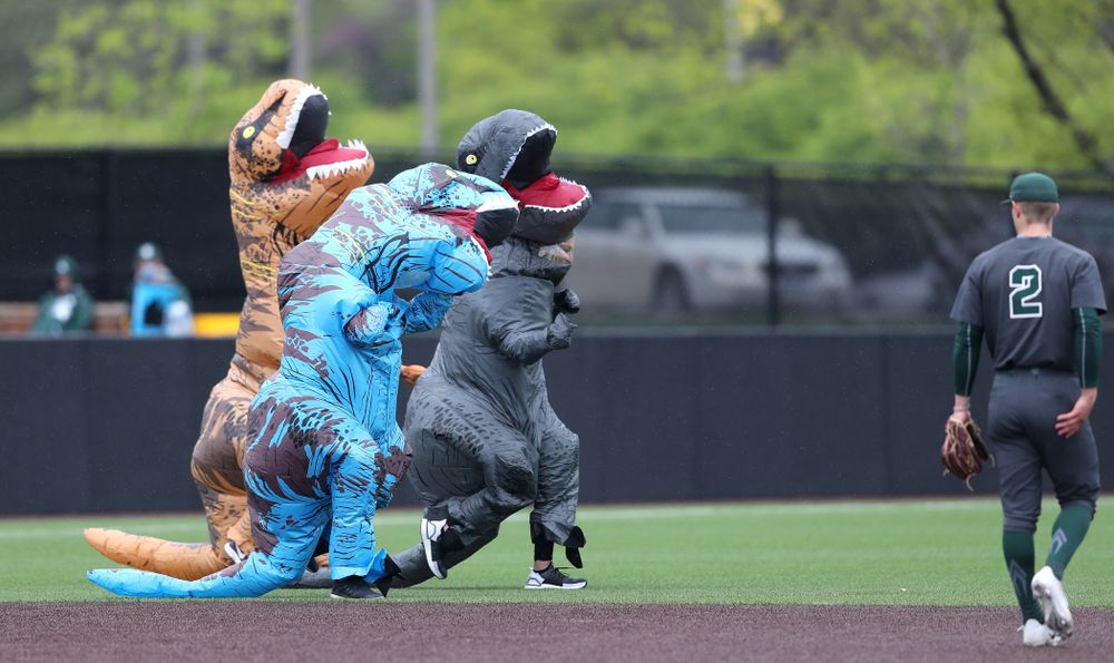 Rachel Heller, Susie Lund, and Emily run the dinosaur race during the Iowa Hawkeyes game against Michigan State Sunday, May 12, 2019 at Duane Banks Field. (Brian Ray/hawkeyesports.com)
