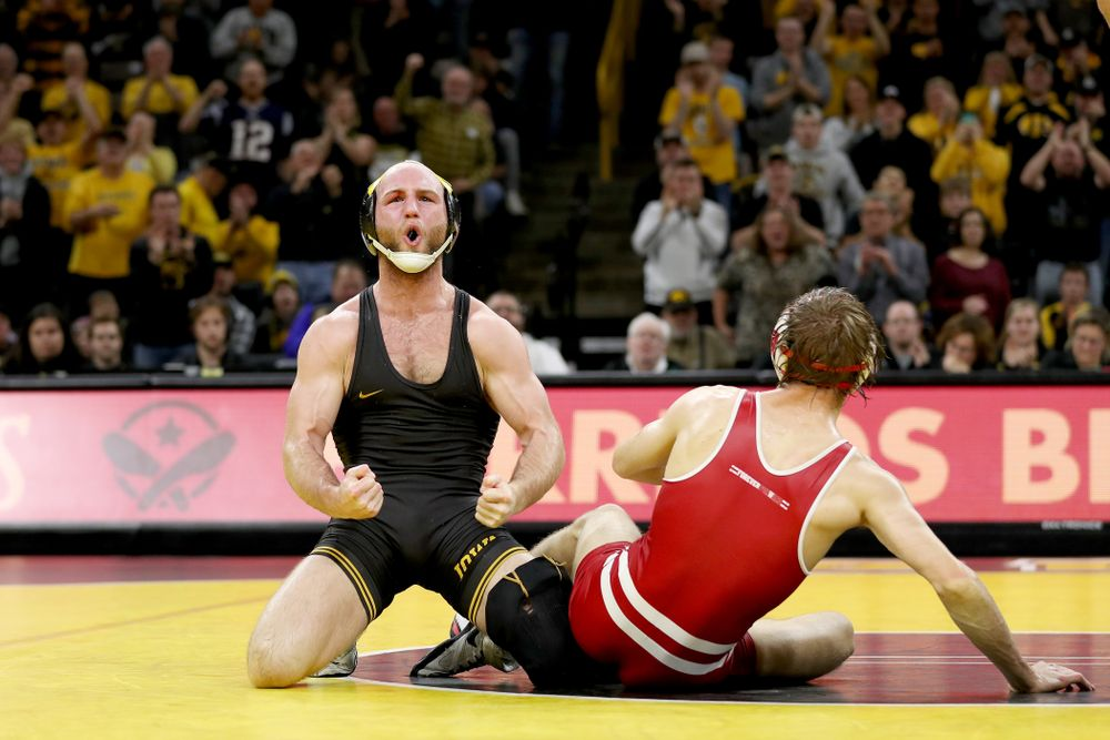 IowaÕs Alex Marinelli celebrates after defeating WisconsinÕs Evan Wick at 165 pounds Sunday, December 1, 2019 at Carver-Hawkeye Arena. Marinelli won the match 4-2. (Brian Ray/hawkeyesports.com)