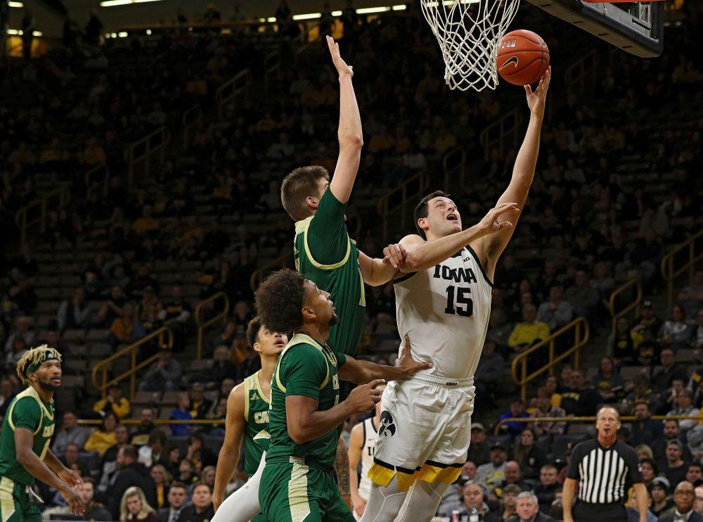 Iowa Hawkeyes forward Ryan Kriener (15) makes a basket during the second half of their game at Carver-Hawkeye Arena in Iowa City on Sunday, Nov 24, 2019. (Stephen Mally/hawkeyesports.com)