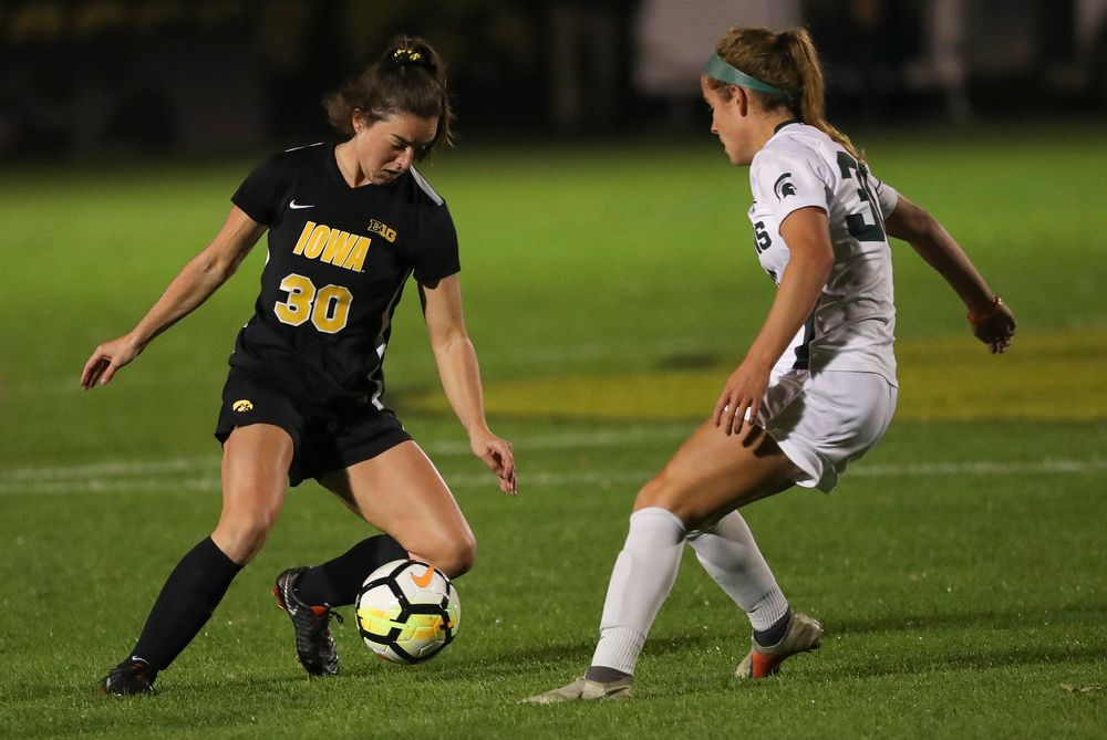 Iowa Hawkeyes forward Devin Burns (30) dribbles the ball during a game against Michigan State at the Iowa Soccer Complex on October 12, 2018. (Tork Mason/hawkeyesports.com)