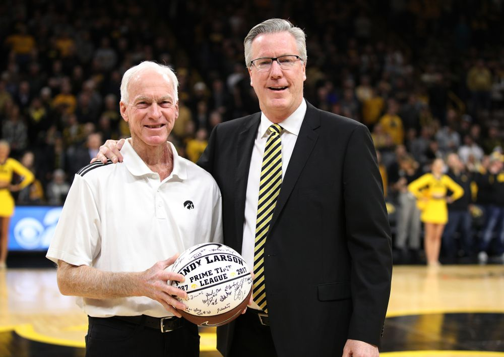 Iowa Hawkeyes head coach Fran McCaffery presents Randy Larson a ceremonial ball for his years of service running the PrimeTime League before their game against the Ohio State Buckeyes Saturday, January 12, 2019 at Carver-Hawkeye Arena. (Brian Ray/hawkeyesports.com)