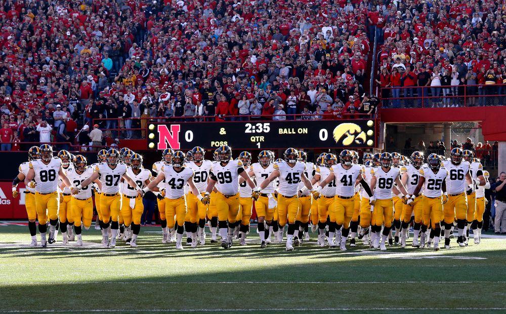 The Iowa Hawkeyes swarm onto he field