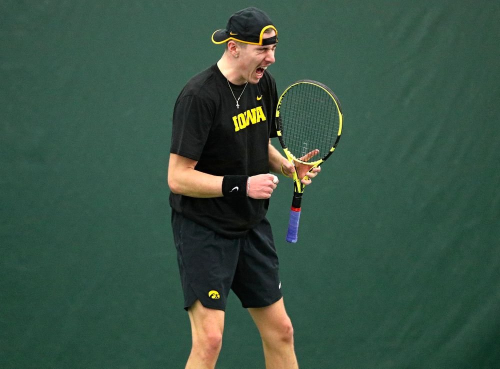 Iowa's Nikita Snezhko celebrates a point during his singles match at the Hawkeye Tennis and Recreation Complex in Iowa City on Friday, February 14, 2020. (Stephen Mally/hawkeyesports.com)
