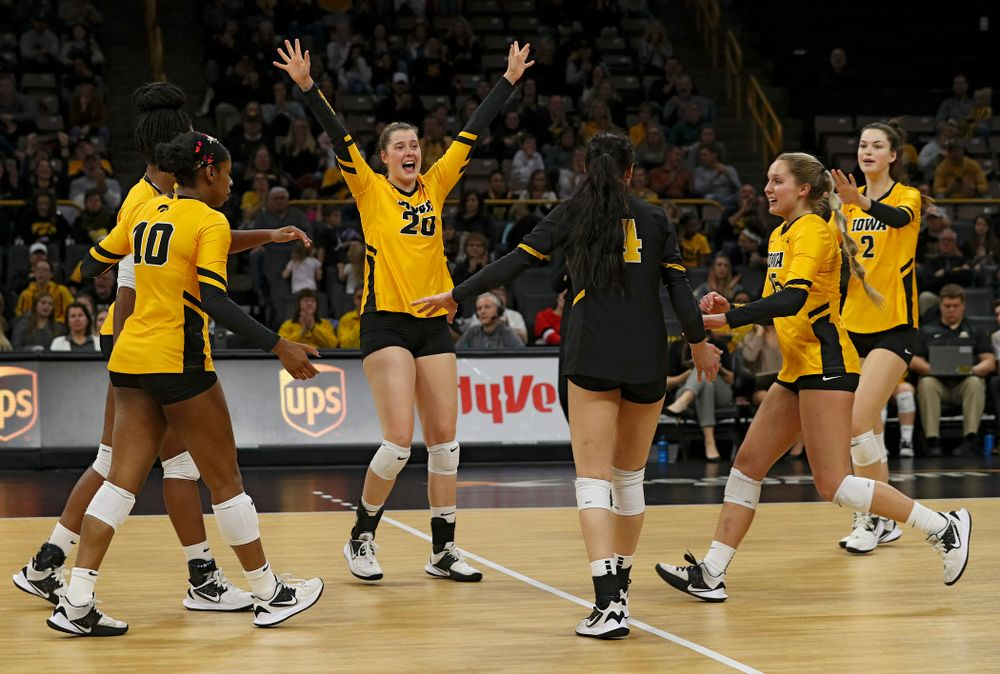 Iowa's Amiya Jones (9), Griere Hughes (10), Edina Schmidt (20), Halle Johnston (4), Maddie Slagle (15), and Courtney Buzzerio (2) celebrate a score during the first set of their match at Carver-Hawkeye Arena in Iowa City on Friday, Nov 29, 2019. (Stephen Mally/hawkeyesports.com)