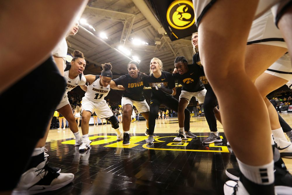 The Iowa Hawkeyes women's basketball team huddles up before a game against North Carolina Central at Carver-Hawkeye Arena on November 17, 2018. (Tork Mason/hawkeyesports.com)