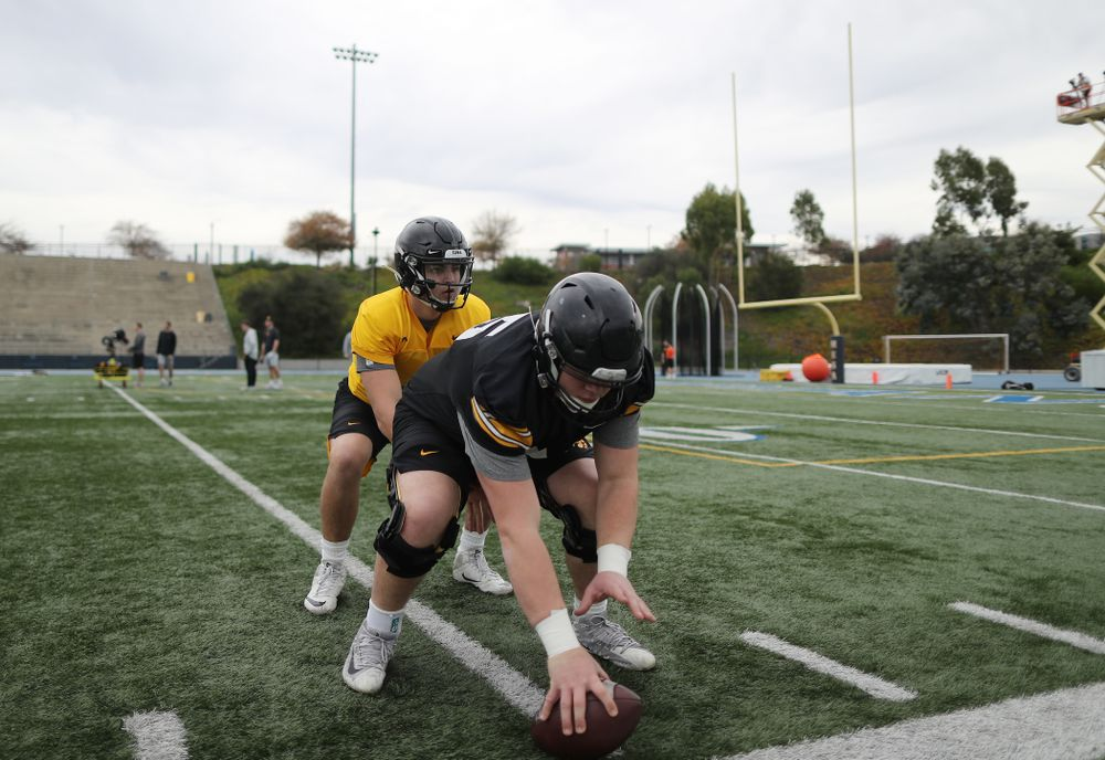 Iowa Hawkeyes offensive lineman Tyler Linderbaum (65) and quarterback Nate Stanley (4) during practice Sunday, December 22, 2019 at Mesa College in San Diego. (Brian Ray/hawkeyesports.com)