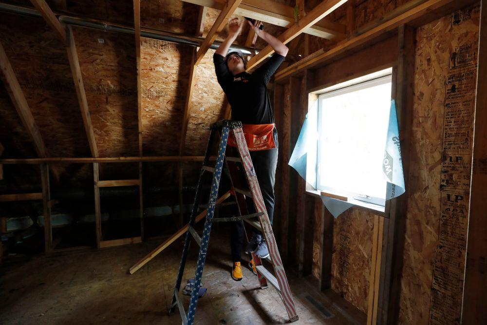 Iowa Hawkeyes forward Megan Gustafson (10) works on the Habitat for Humanity Women's Build Wednesday, September 26, 2018 in Iowa City. (Brian Ray/hawkeyesports.com)