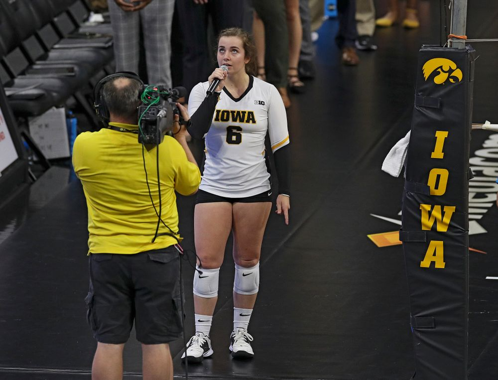 Iowa's Emma Lowes (6) sings the National Anthem before their Big Ten/Pac-12 Challenge match against Colorado at Carver-Hawkeye Arena in Iowa City on Friday, Sep 6, 2019. (Stephen Mally/hawkeyesports.com)