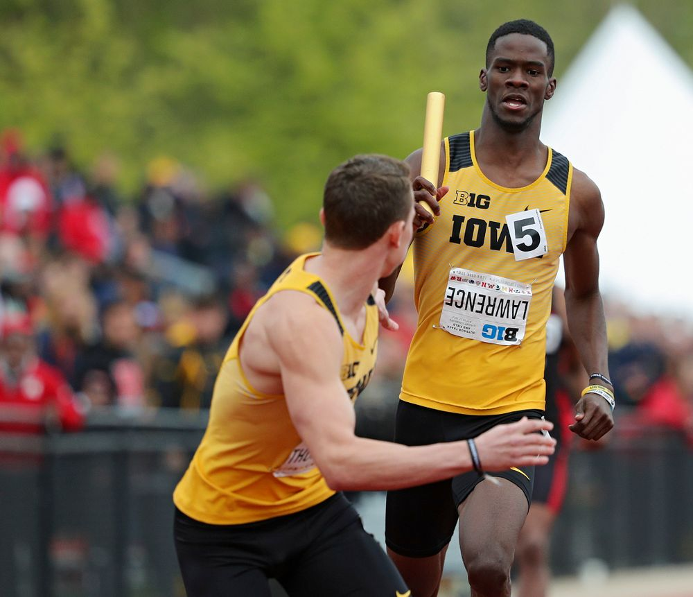 Iowa's Wayne Lawrence Jr. (rights) hands the baton off to Chris Thompson during the 1600 meter relay event on the third day of the Big Ten Outdoor Track and Field Championships at Francis X. Cretzmeyer Track in Iowa City on Sunday, May. 12, 2019. (Stephen Mally/hawkeyesports.com)