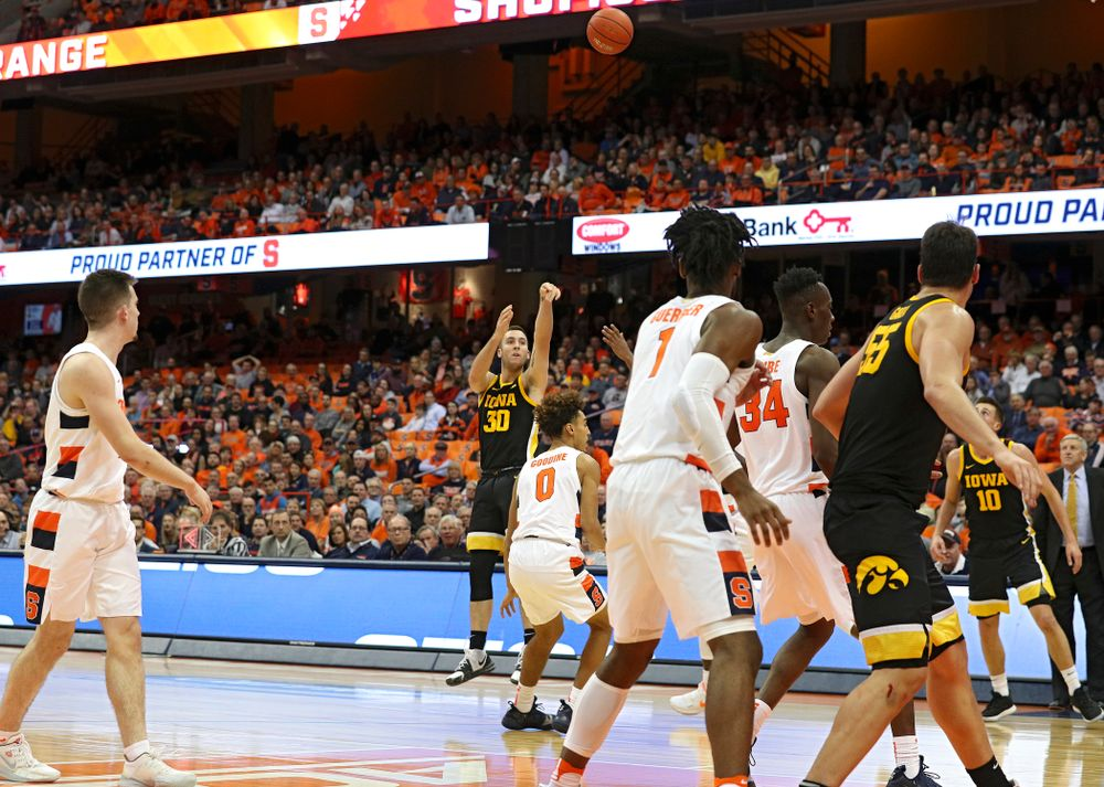 Iowa Hawkeyes guard Connor McCaffery (30) makes a 3-pointer during the second half of their ACC/Big Ten Challenge game at the Carrier Dome in Syracuse, N.Y. on Tuesday, Dec 3, 2019. (Stephen Mally/hawkeyesports.com)