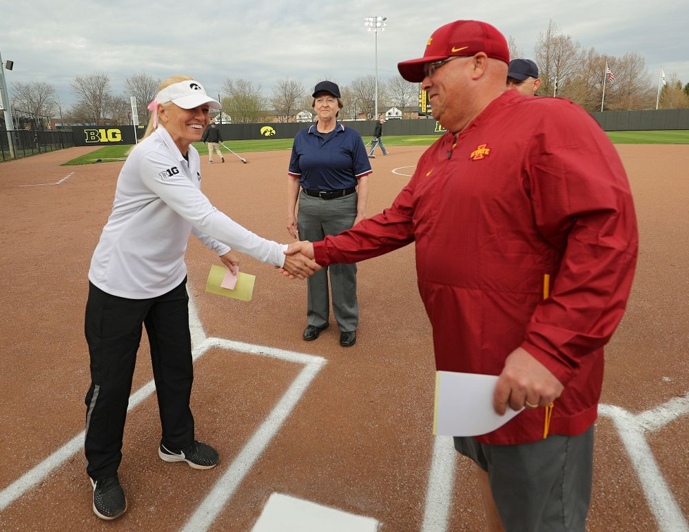Iowa head coach Renee Gillispie shakes hands with Iowa State head coach Jamie Pinkerton before their game against Iowa State at Pearl Field in Iowa City on Tuesday, Apr. 9, 2019. (Stephen Mally/hawkeyesports.com)
