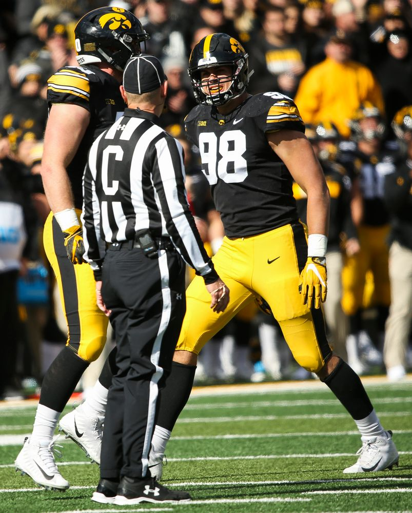Iowa Hawkeyes defensive end Anthony Nelson (98) reacts after Iowa Hawkeyes defensive end Parker Hesse (40) sacks the quarterback during a game against Maryland at Kinnick Stadium on October 20, 2018. (Tork Mason/hawkeyesports.com)