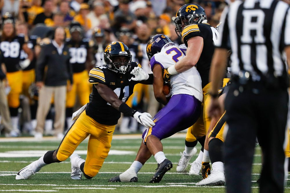 Iowa Hawkeyes defensive back Michael Ojemudia (11) makes a tackle during a game against Northern Iowa at Kinnick Stadium on September 15, 2018. (Tork Mason/hawkeyesports.com)