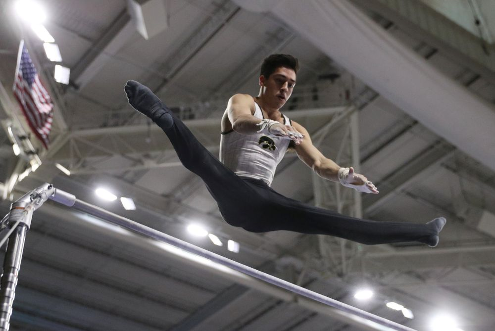 Iowa's Andrew Herrador competes on the high bar against UIC and Minnesota Saturday, February 2, 2019 at Carver-Hawkeye Arena. (Brian Ray/hawkeyesports.com)