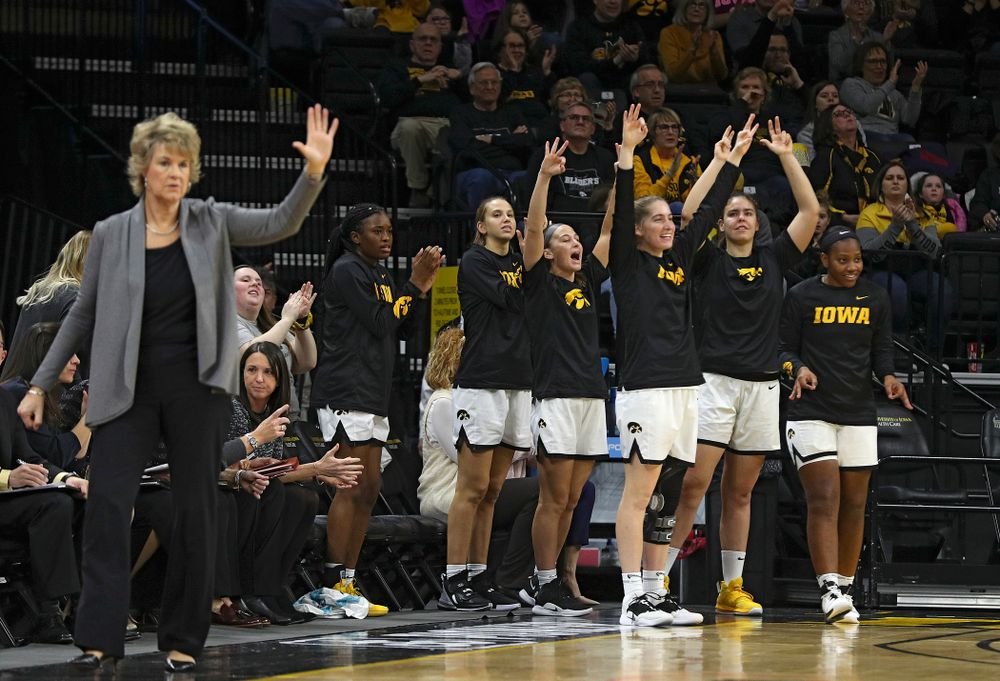 The Iowa bench celebrates after a 3-pointer during the first quarter of their game at Carver-Hawkeye Arena in Iowa City on Sunday, January 12, 2020. (Stephen Mally/hawkeyesports.com)