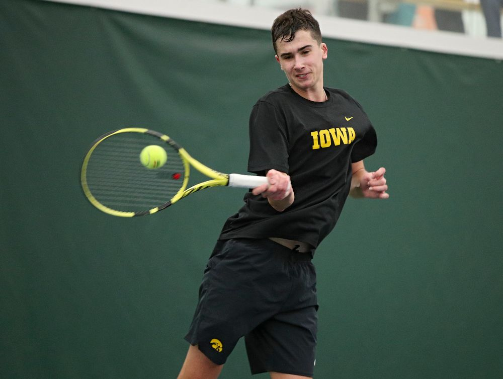 Iowa's Matt Clegg hits a shot during his match against Marquette at the Hawkeye Tennis and Recreation Complex in Iowa City on Saturday, January 25, 2020. (Stephen Mally/hawkeyesports.com)