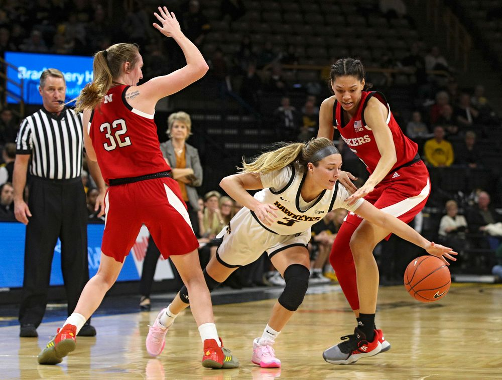Iowa Hawkeyes guard Makenzie Meyer (3) splits two defenders during the second quarter of the game at Carver-Hawkeye Arena in Iowa City on Thursday, February 6, 2020. (Stephen Mally/hawkeyesports.com)