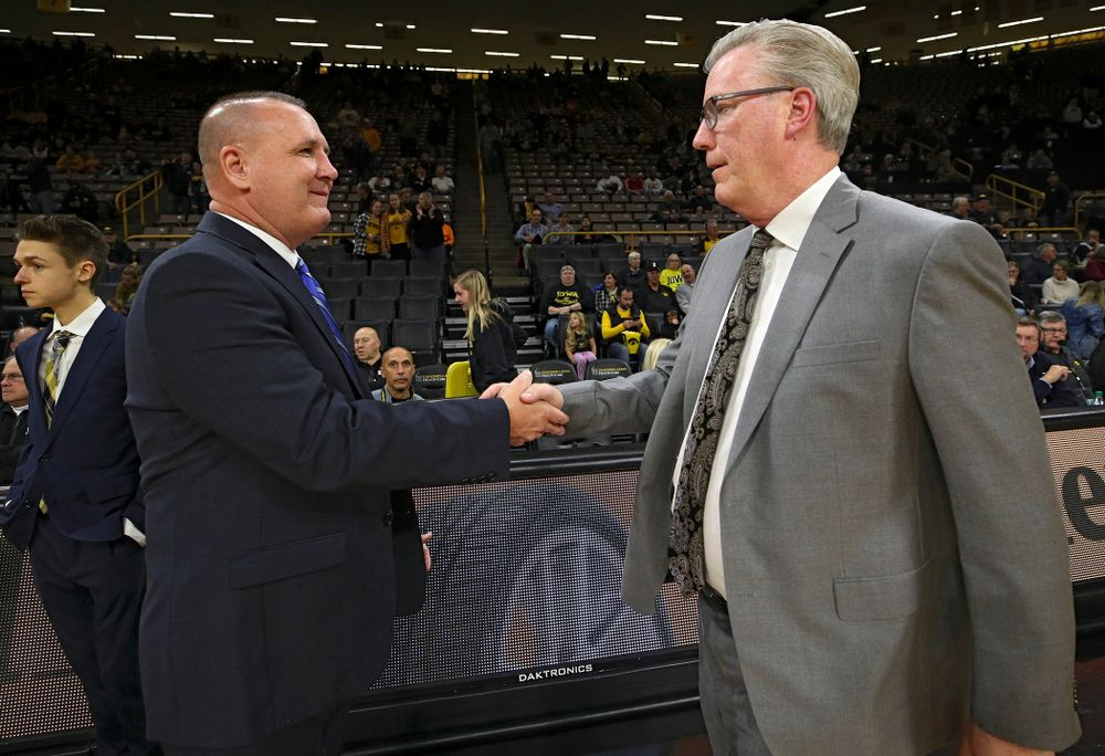 Lindsey Wilson College head coach Keith Adkins (from left) shakes hands with Iowa Hawkeyes head coach Fran McCaffery before their exhibition game against Lindsey Wilson College at Carver-Hawkeye Arena in Iowa City on Monday, Nov 4, 2019. (Stephen Mally/hawkeyesports.com)