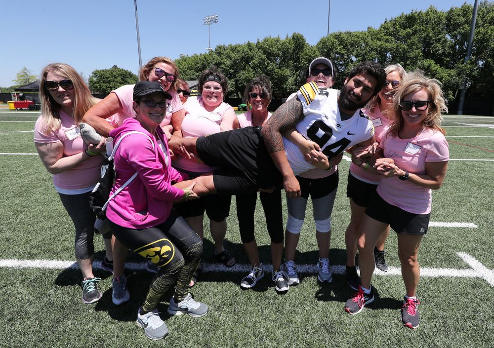Iowa Hawkeyes defensive end A.J. Epenesa (94) is picked up by a group of women during the 2019 Iowa Ladies Football Academy Saturday, June 8, 2019 at the Hansen Football Performance Center. (Brian Ray/hawkeyesports.com)
