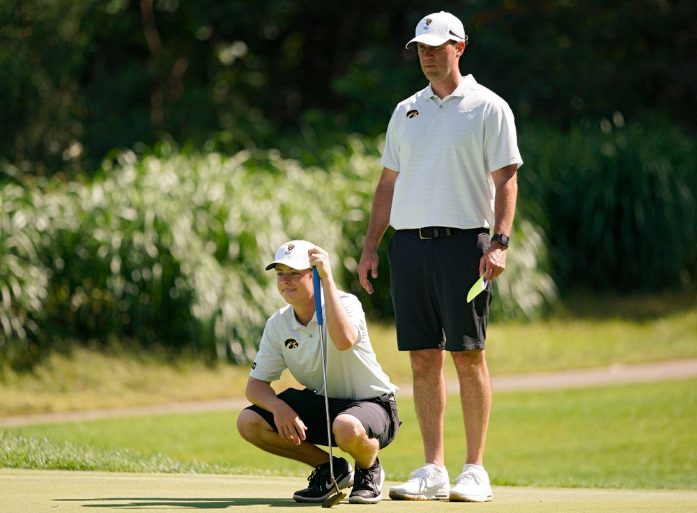 Iowa's Matthew Garside (from left) lines up a putt as head coach Tyler Stith looks on during the second day of the Golfweek Conference Challenge at the Cedar Rapids Country Club in Cedar Rapids on Monday, Sep 16, 2019. (Stephen Mally/hawkeyesports.com)