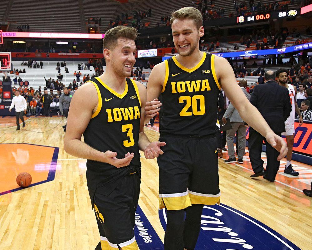Iowa Hawkeyes guard Jordan Bohannon (3) and forward Riley Till (20) talk after winning their ACC/Big Ten Challenge game at the Carrier Dome in Syracuse, N.Y. on Tuesday, Dec 3, 2019. (Stephen Mally/hawkeyesports.com)