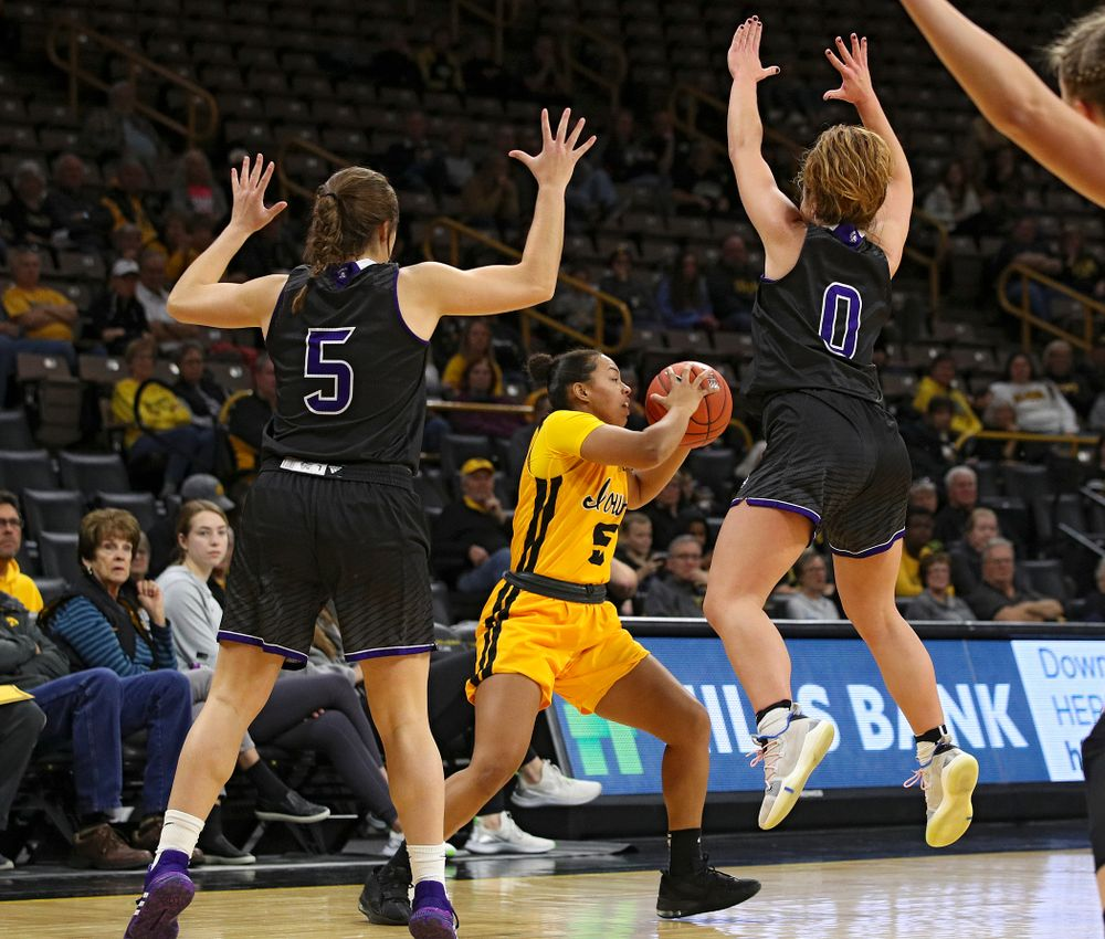 Iowa guard Alexis Sevillian (5) looks to pass during the third quarter of their game against Winona State at Carver-Hawkeye Arena in Iowa City on Sunday, Nov 3, 2019. (Stephen Mally/hawkeyesports.com)
