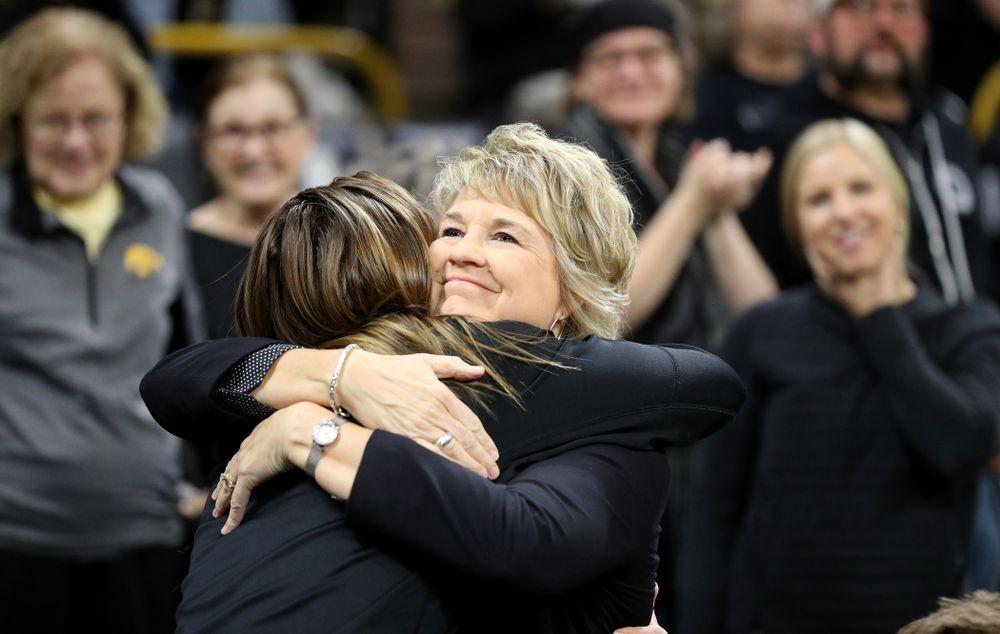 Iowa Hawkeyes head coach Lisa Bluder hugs former player Hannah Stewart before their game against Clemson Wednesday, December 4, 2019 at Carver-Hawkeye Arena. (Brian Ray/hawkeyesports.com)