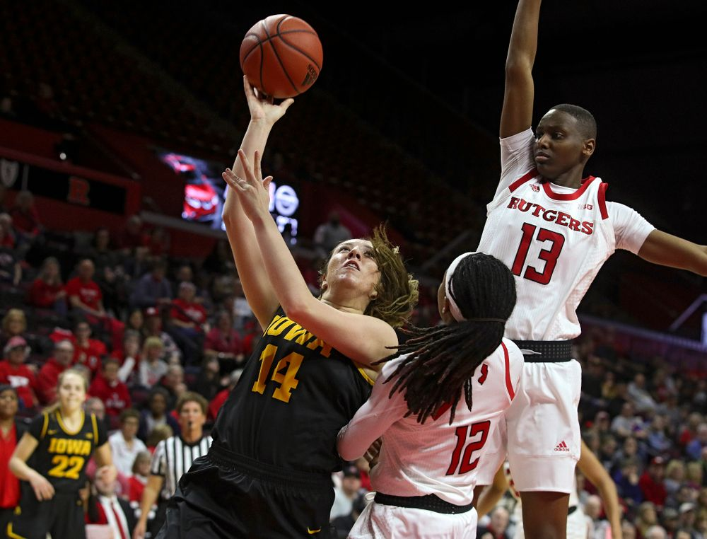Iowa guard/forward McKenna Warnock (14) makes a basket while being fouled during the second quarter of their game at the Rutgers Athletic Center in Piscataway, N.J. on Sunday, March 1, 2020. (Stephen Mally/hawkeyesports.com)