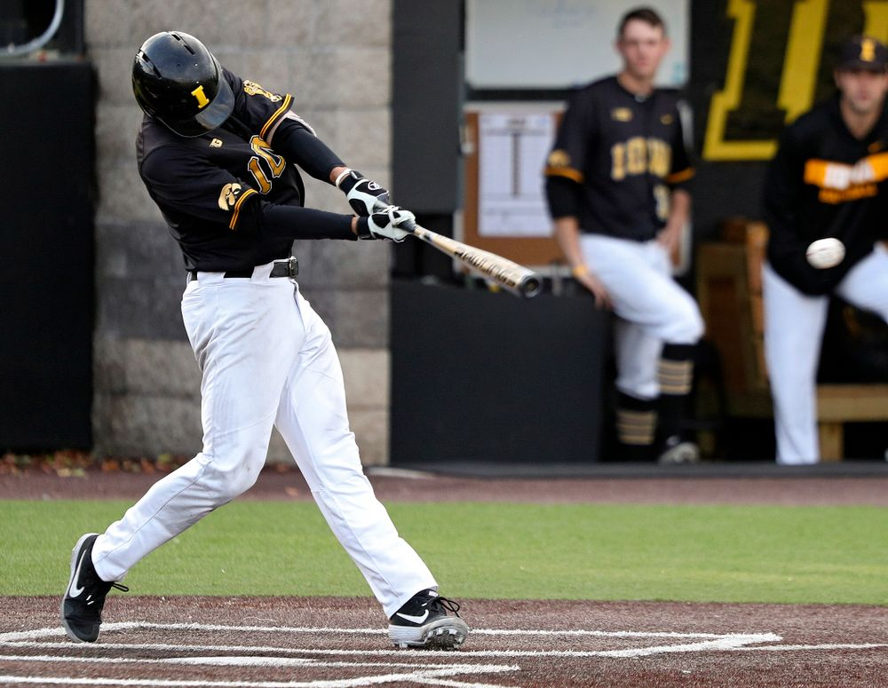 Iowa Dylan Nedved (17) drives a pitch for a hit during the fifth inning of the first game of the Black and Gold Fall World Series at Duane Banks Field in Iowa City on Tuesday, Oct 15, 2019. (Stephen Mally/hawkeyesports.com)