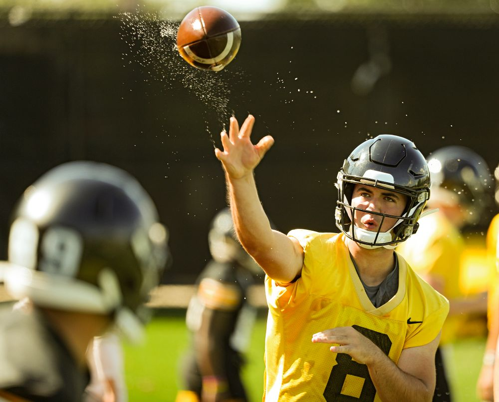 Iowa Hawkeyes quarterback Alex Padilla (8) throws a wet football as they run a drill during Fall Camp Practice No. 13 at the Hansen Football Performance Center in Iowa City on Friday, Aug 16, 2019. (Stephen Mally/hawkeyesports.com)