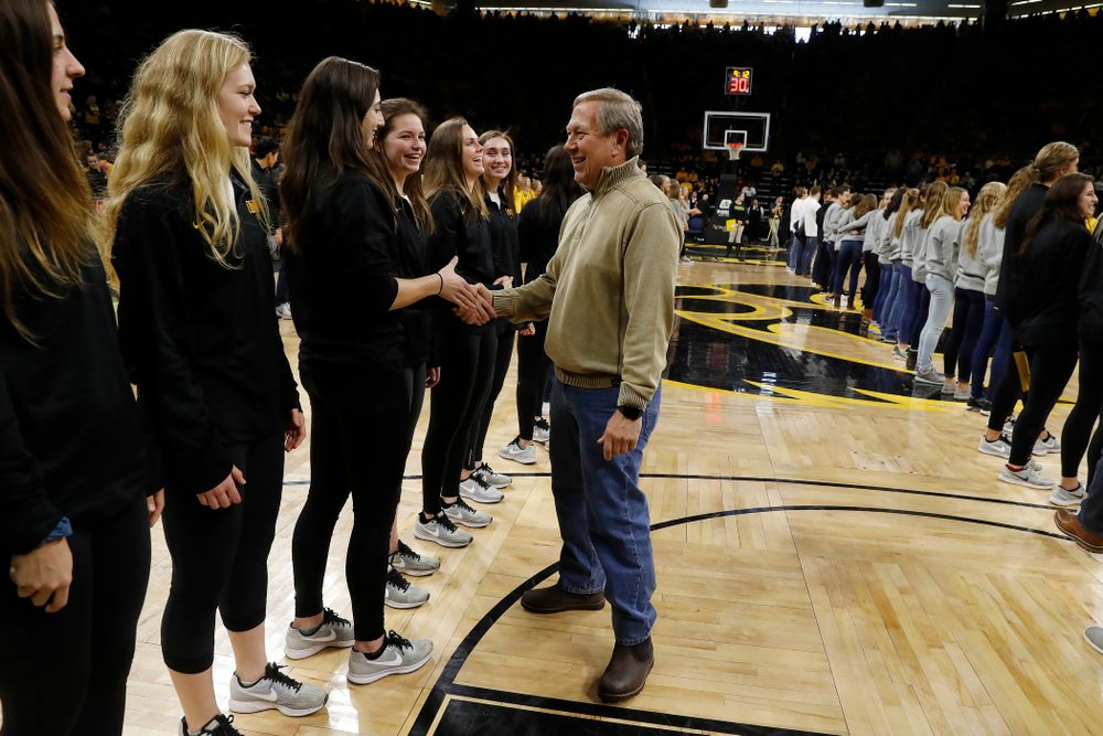 University of Iowa President Bruce Harreld shakes hands with the soccer team during the PCA recognition