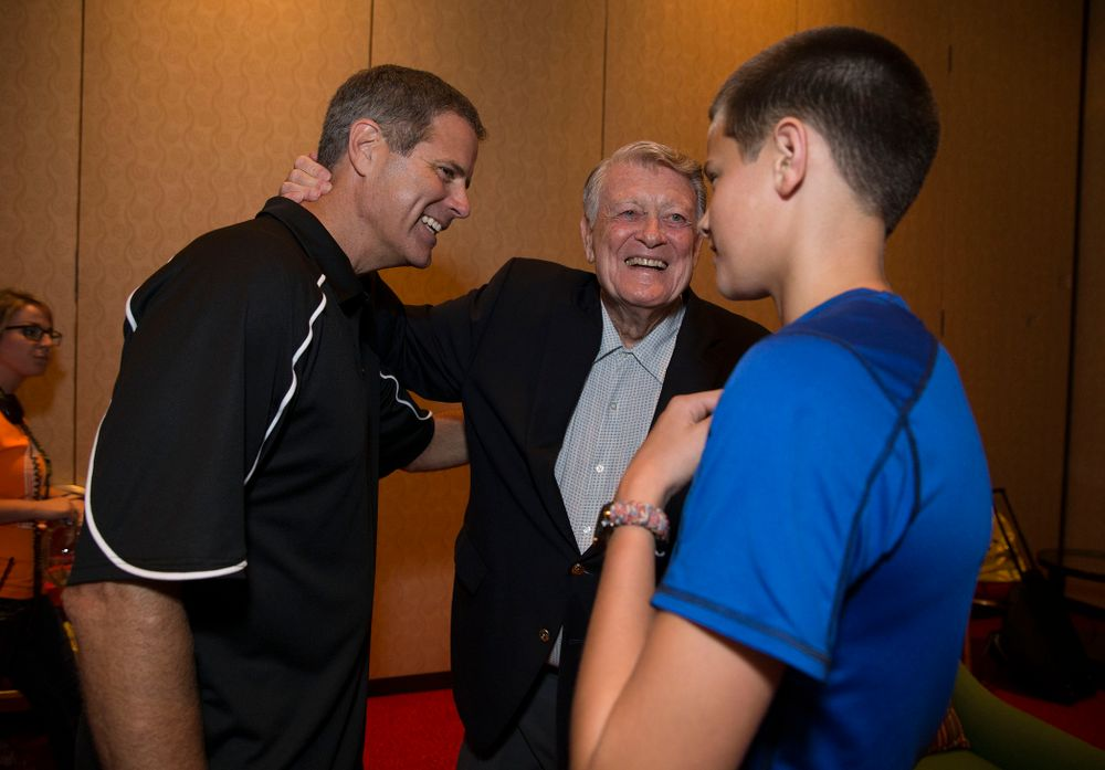 Former Hawkeye Football Head Coach Hayden Fry talks with former quarterback  Mark Vlasic and his son before a panel discussion during Fry Fest Friday, Aug. 29, 2014 in Coralville.  (Brian Ray/hawkeyesports.com)