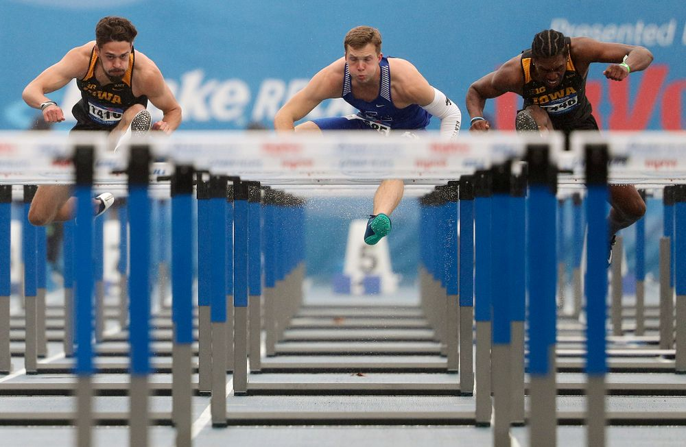 Iowa's Josh Braverman (left) and Anthony Williams (right) run the men's 110 meter hurdles event during the third day of the Drake Relays at Drake Stadium in Des Moines on Saturday, Apr. 27, 2019. (Stephen Mally/hawkeyesports.com)