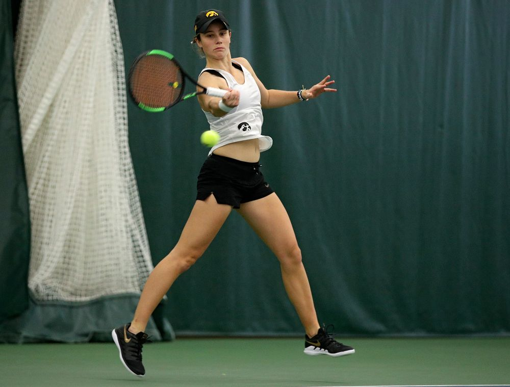 Iowa's Elise Van Heuvelen returns a shot during her singles match at the Hawkeye Tennis and Recreation Complex in Iowa City on Sunday, February 23, 2020. (Stephen Mally/hawkeyesports.com)
