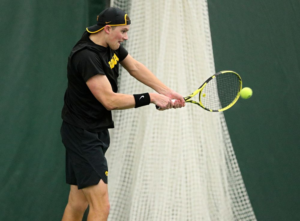 Iowa's Joe Tyler returns a shot during his singles match at the Hawkeye Tennis and Recreation Complex in Iowa City on Friday, February 14, 2020. (Stephen Mally/hawkeyesports.com)