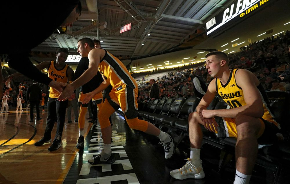 Iowa Hawkeyes guard Connor McCaffery (30) is introduced while guard Joe Wieskamp (10) waits before their game at Carver-Hawkeye Arena in Iowa City on Monday, Nov 11, 2019. (Stephen Mally/hawkeyesports.com)