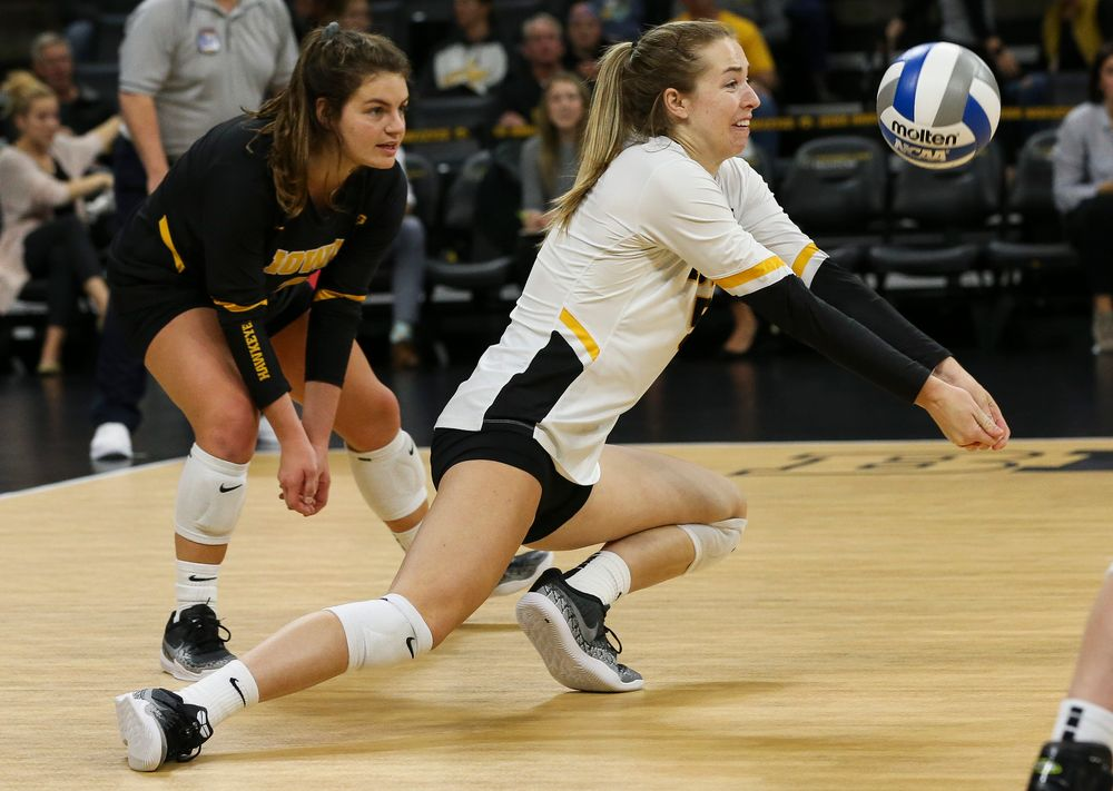 Iowa Hawkeyes outside hitter Meghan Buzzerio (5) digs the ball during a game against Purdue at Carver-Hawkeye Arena on October 13, 2018. (Tork Mason/hawkeyesports.com)