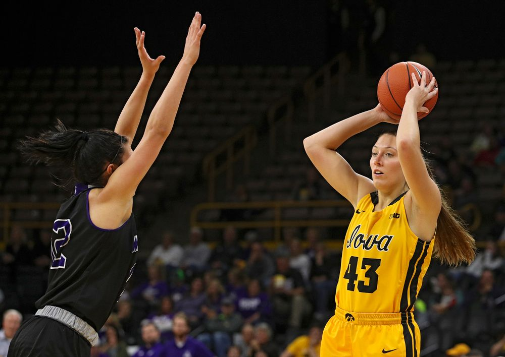 Iowa forward Amanda Ollinger (43) looks to pass during the third quarter of their game against Winona State at Carver-Hawkeye Arena in Iowa City on Sunday, Nov 3, 2019. (Stephen Mally/hawkeyesports.com)