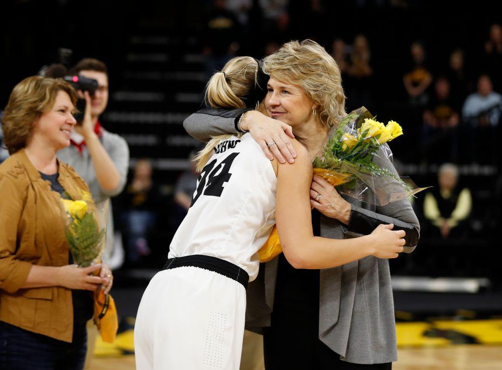 Iowa Hawkeyes forward Carly Mohns (34) and head coach Lisa Bluder