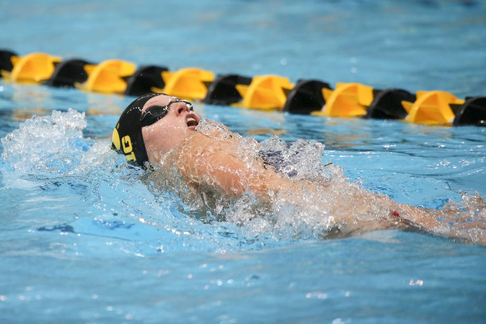 Iowa's Julia Koluch 100-yard backstroke during the Iowa swimming and diving meet vs Notre Dame and Illinois on Saturday, January 11, 2020 at the Campus Recreation and Wellness Center. (Lily Smith/hawkeyesports.com)