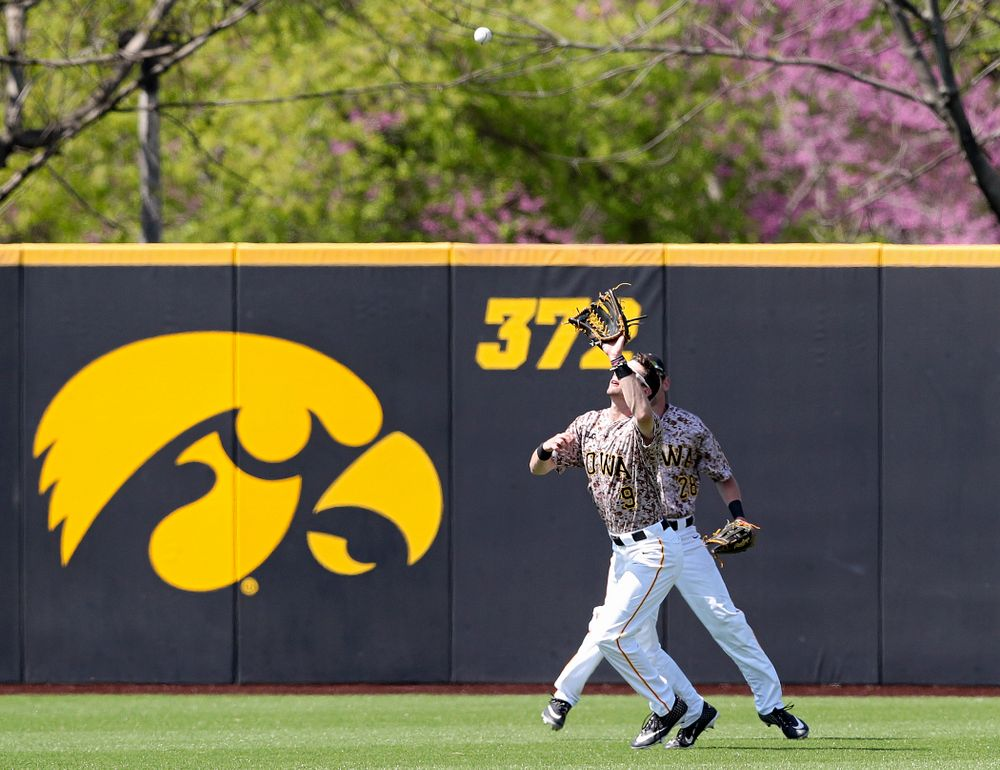 Iowa Hawkeyes center fielder Ben Norman (9) pulls in a fly ball for an out during the fifth inning of their game against UC Irvine at Duane Banks Field in Iowa City on Sunday, May. 5, 2019. (Stephen Mally/hawkeyesports.com)