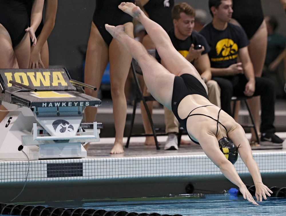 Iowa's Lauren McDougall dives into the pool as she swims her section of the women's 200-yard freestyle relay event during their meet against Michigan State at the Campus Recreation and Wellness Center in Iowa City on Thursday, Oct 3, 2019. (Stephen Mally/hawkeyesports.com)