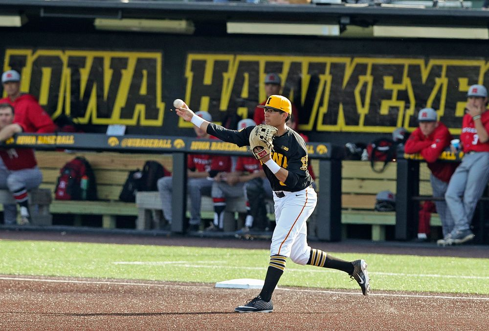 Iowa Hawkeyes third baseman Matthew Sosa (31) throws to second base as they turn a double play during the eighth inning of their game against Rutgers at Duane Banks Field in Iowa City on Saturday, Apr. 6, 2019. (Stephen Mally/hawkeyesports.com)