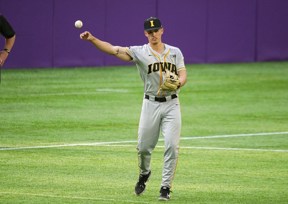 Iowa Hawkeyes infielder Dylan Nedved (17) throw the ball back to the pitcher during the seventh inning of their CambriaCollegeClassic game at U.S. Bank Stadium in Minneapolis, Minn. on Friday, February 28, 2020. (Stephen Mally/hawkeyesports.com)