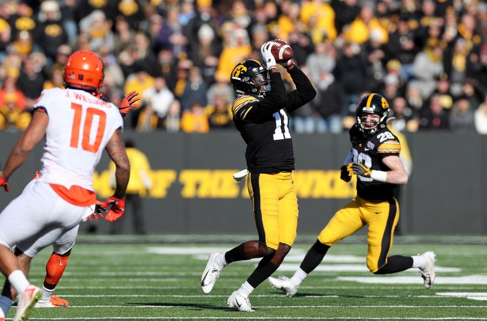 Iowa Hawkeyes defensive back Michael Ojemudia (11) intercepts a pass against the Illinois Fighting Illini Saturday, November 23, 2019 at Kinnick Stadium. (Brian Ray/hawkeyesports.com)