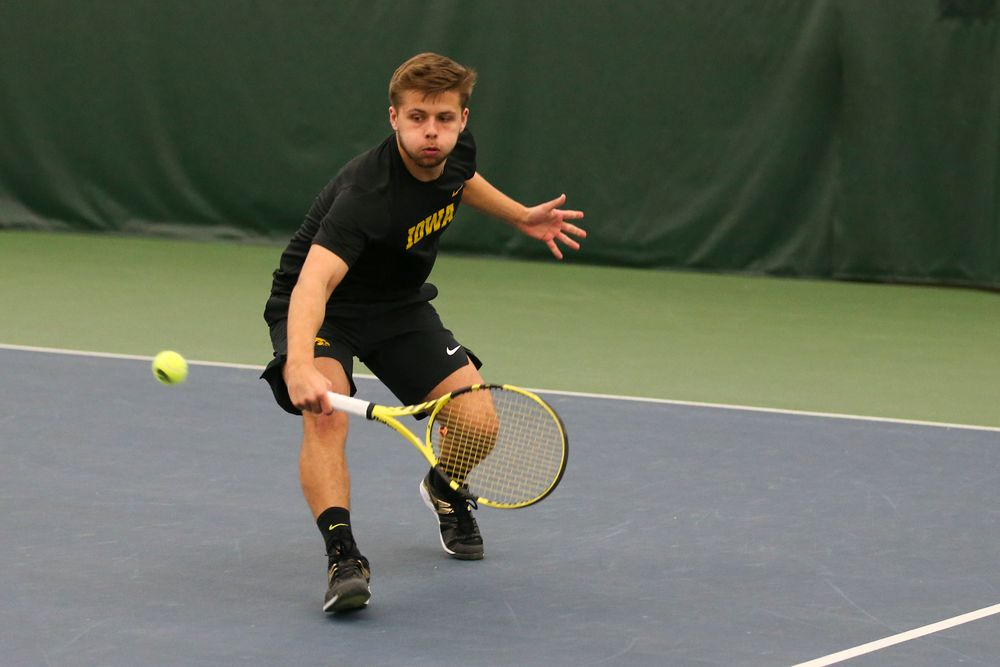Iowa's Will Davies returns a ball during the Iowa men's tennis meet vs VCU  on Saturday, February 29, 2020 at the Hawkeye Tennis and Recreation Complex. (Lily Smith/hawkeyesports.com)