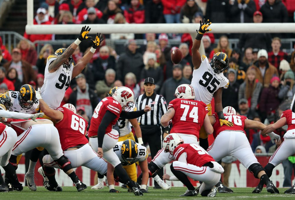 Iowa Hawkeyes defensive end A.J. Epenesa (94) and defensive lineman Cedrick Lattimore (95) against the Wisconsin Badgers Saturday, November 9, 2019 at Camp Randall Stadium in Madison, Wisc. (Brian Ray/hawkeyesports.com)