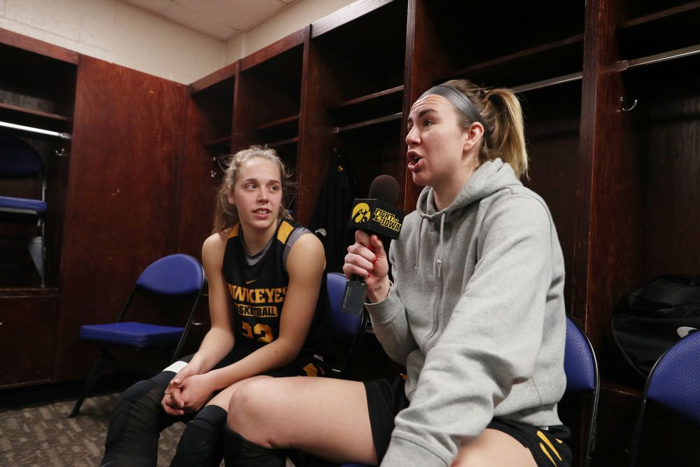 Iowa Hawkeyes forward Hannah Stewart (21) and guard Kathleen Doyle (22) during media and practice as they prepare for their Sweet 16 matchup against NC State Friday, March 29, 2019 at the Greensboro Coliseum in Greensboro, NC.(Brian Ray/hawkeyesports.com)