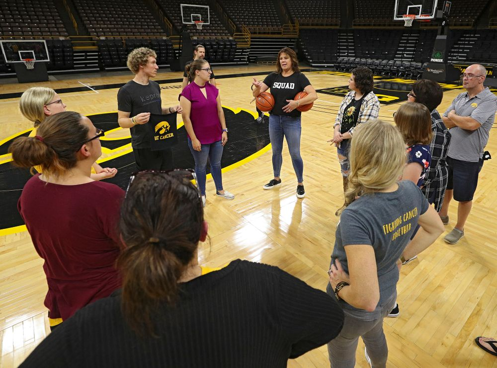 Margaret McCaffery talks with visitors from the University of Iowa Hospitals and Clinics Adolescent and Young Adult (AYA) Cancer Program at Carver-Hawkeye Arena in Iowa City on Monday, Sep 30, 2019. (Stephen Mally/hawkeyesports.com)